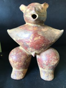 Original ceramic pre-Columbian archaeological find  in Cauca medio region -Colombia.  Anthropomorphic statuette stylized with animal head. Dimensions : 25 cm x 19 cm