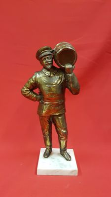 A sculpture of a captain upon a marble base