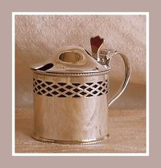 Sterling silver George V pierced mustard pot w/ blue glass liner, Levi and Salman, Birmingham, 1924