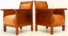 Two oak Art Deco armchairs