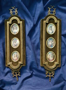 Pair of picture frames, each with three ivory oval miniatures depicting ladies - England, 19th century