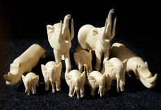 10 Handcarved Ivory pieces, 2 rhino's and 8 elephant's - Unknown country of origin