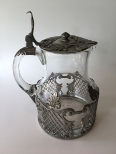 Art Nouveau crystal carafe with tin decoration