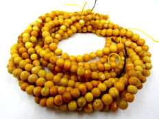 5 Old Amber beaded strands, bee wax colour, from first half of 20 century, weight: 68,9 gr.