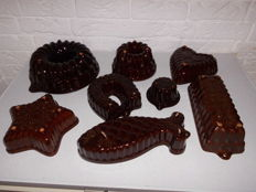 Collection of 8 intact pudding shapes from the 1970s, some numbered, in various designs