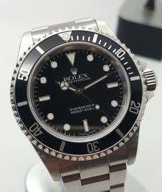 Rolex Submariner 14060M box and warranty 2001