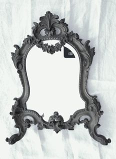 Bronze wall mirror, decorated with scrolls and a garland on top - France, late 19th century