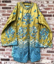 A Yellow ground embroidered silk Dragon image robe - China - First half  20th century