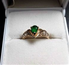 "Yellow gold ring with ""Pear"" Emerald of 0.55 ct and 6 Diamonds total 0.10 ct - Weight: 2.21 g."