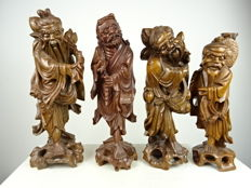 Four hardwood statues - China - second half 20th century