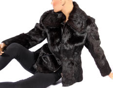 Fashionable fur jacket made of rabbit fur, dark with zip