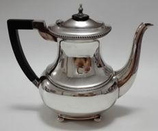 A silver plate coffeepot with wooden handle on 4 feet - Germany, WMF, 1st half of the 20th century