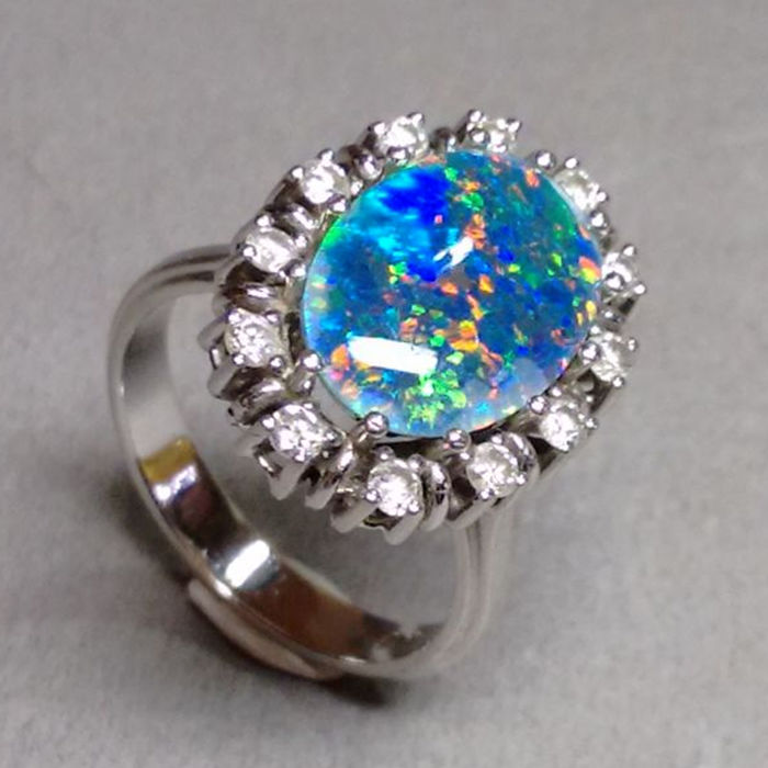 Opal ring in white gold with brilliants approx. 0.50 ct and opal triplette