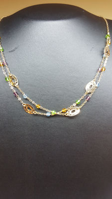18 kt double necklace set with various stones.