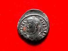 Roman Empire - Licinius I (308-324 A.D.) bronze follis (3,31 g. 17 mm.) from Cyzicus mint. 317-320 A.D. IOVI CONSERVATORI AVG.