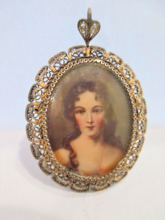 Oval brooch with a portrait of a woman's face, 20th century