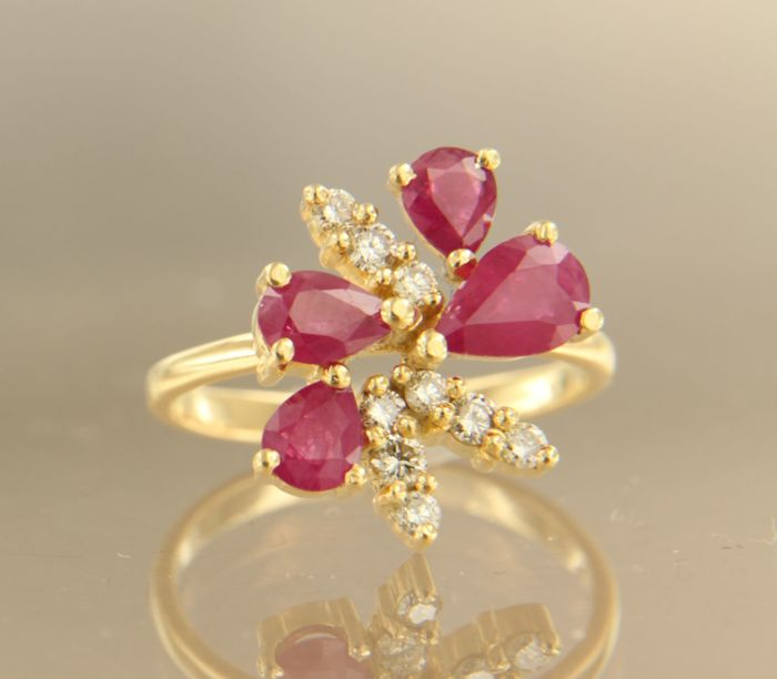 18 kt yellow gold ring set with 4 pear-shape cut rubies and 9 brilliant cut diamonds, ring size 17.25 (54)