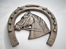 Bronze coloured metal alloy (hanging) horseshoe with a horse head - second half of the 20th century