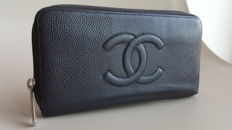 Chanel caviar wallet.
