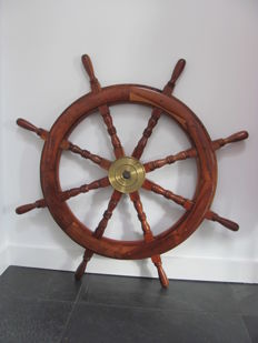 Large wooden helm/steering wheel with key