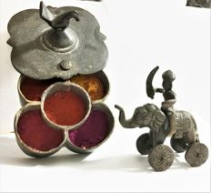 Tika / colour powder container with colour powder and toy of warrior on elephant - India - around 1900