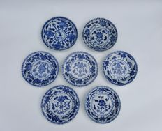 Seven white-blue dishes, floral decoration - China - Kangxi period (1661 - 1722)