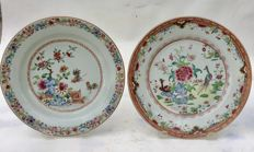 Two famille Rose porcelain dishes depicting a pair of Peacocks and the other with Roosters - China - 18th century.
