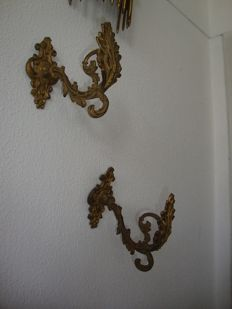 A pair of gilt bronze curtain holders in Napoleon III style, circa 1900