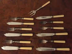 A 13 part silver plated fish cutlery with probebly  ivory handles