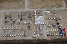 collection of 90 silver plated and silver spoons -- knives -- forks -- cake server -- gravy spoon from around the world