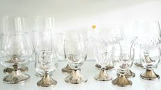 Lot of crystal glasses with silver plated base.