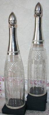 Pair of Baccarat cut crystal decanters with sterling silver mounts, Minerva's head hallmarks 1st grade 950/1000, silversmith's mark: Aubriot, Edouard 1885, Paris