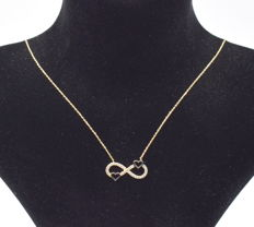 14 carat yellow gold necklace  with Entire pendant  42 cm