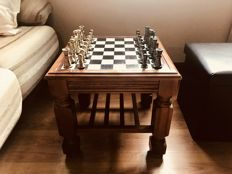Chess table made of cherry wood with metal pieces.