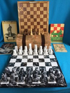 1 marble chess set, 4 chess books, 1 chess set combined with other games in a landscape box