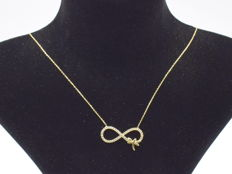 14 carat yellow gold necklace  with Infinity pendant