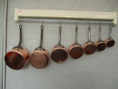 Seven beautiful copper saucepans