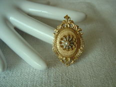 Antique gold medallion with pearl and diamonds