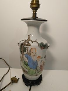 Vase with installed lamp of the rose family in porcelain with paintings of elders and children – China – circa 1910.