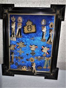 Antique wooden frame in black paint with gold plating and 24 rare war merit badges