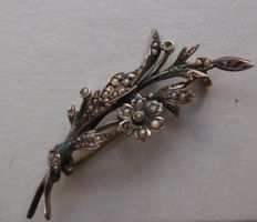 Old silver brooch inlaid with natural seed pearls