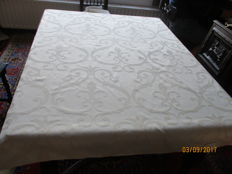 Table cloth of shiny damask - white with beige incorporated motifs.