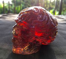 Carved deep Blue/Fire Amber large fluorescent Skull, one piece carving, 121 grams