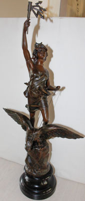 Large sculpture of a female figure on the back of an eagle in bronzed zamak - France - approx. 1900