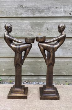 Two stylish art deco sculptures/candle holders