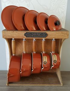 Set of five pots (Le Creuset Made in France) in cast iron enamel with holder