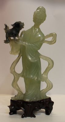 Guan Yin with dog in green jadeite - China - mid-20th century
