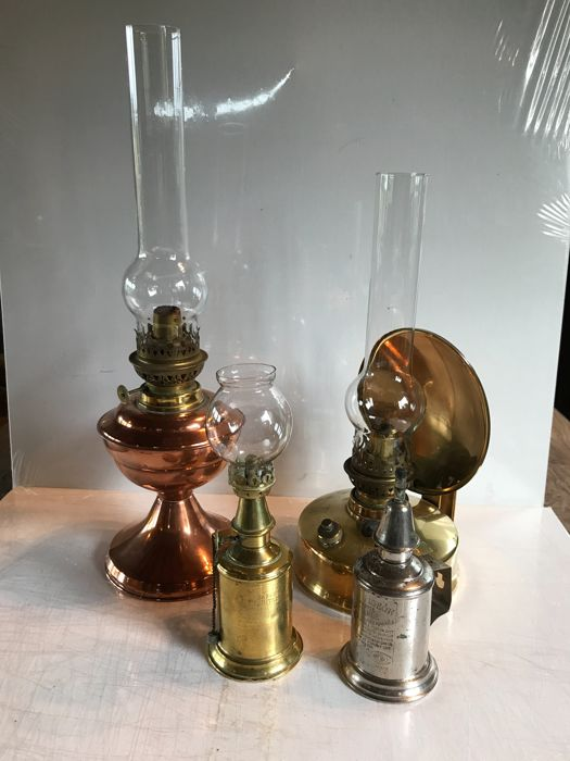 "Lot of one oil lamp with a body in red copper and wide glass, of one oil lamp brand ""Abeille"" all in brass and two real Pigeon lamps in brass - France - 1920s-1940s"