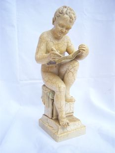 Cast marble statue of writing child -France - approx.1920/1930