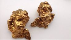 Two large cherubs in gilded wood